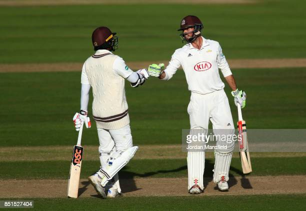 Kumar Sangakkara and Ben Foakes of Surrey come together in the middle during day four of the Specsavers County Championship Division One match...