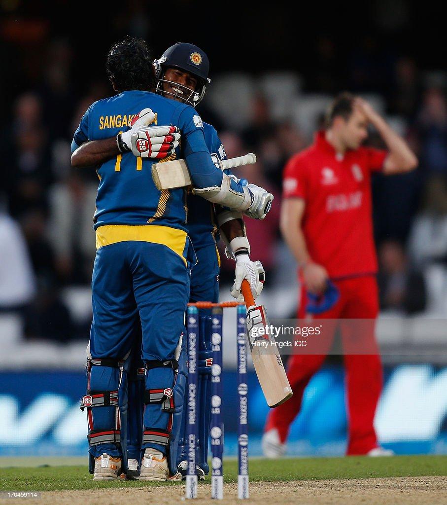 Kumar Sangakkara and Nuwan Kulasekara of Sri Lanka celebrate winning the ICC Champions Trophy group A match between England and Sri Lanka at The Kia Oval on June 13, 2013 in London, England.