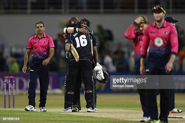 Kumar Sangakkara celebrates hitting the winning runs off the final ball with Jade Dernbach of Surrey as Mohammad Azharullah of Northants is dejected...
