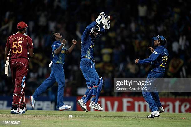 Kumar Sangakkara Mahela Jayawardene and Ajantha Mendis of Sri Lanka celebrates the wicket of Kieron Pollard during the ICC World Twenty20 2012 Super...
