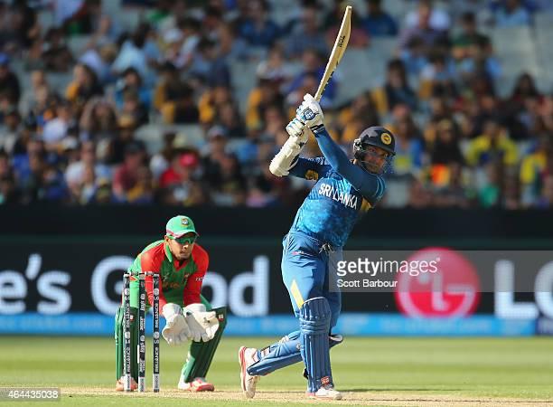 Kumar Sangakkara of Sri Lanka bats as wicketkeeper Mushfiqur Rahim of Bangladesh looks on during the 2015 ICC Cricket World Cup match between Sri...