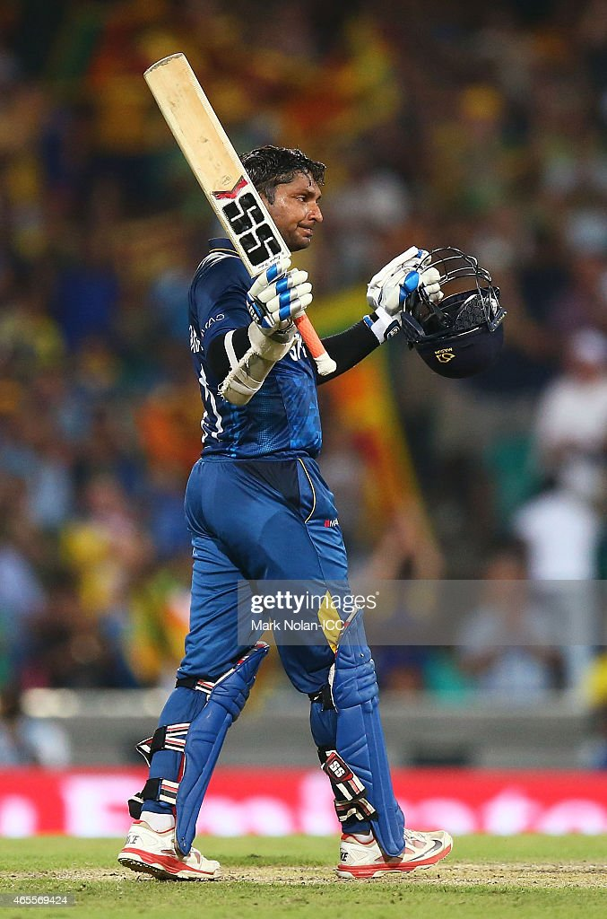 Kumar Sangakkara of Sri Lanka celebrates and acknowledges the crowd after scoring a century during the 2015 ICC Cricket World Cup match between Australia and Sri Lanka at Sydney Cricket Ground on March 8, 2015 in Sydney, Australia.