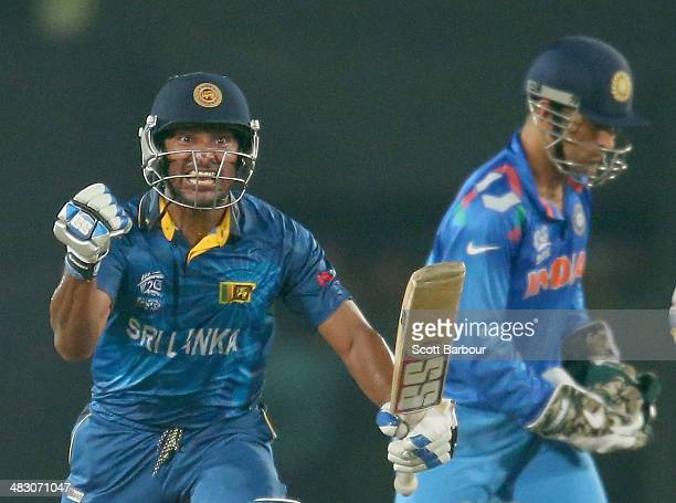 Kumar Sangakkara of Sri Lanka celebrates in the final over as MS Dhoni of India looks on during the Final of the ICC World Twenty20 Bangladesh 2014...