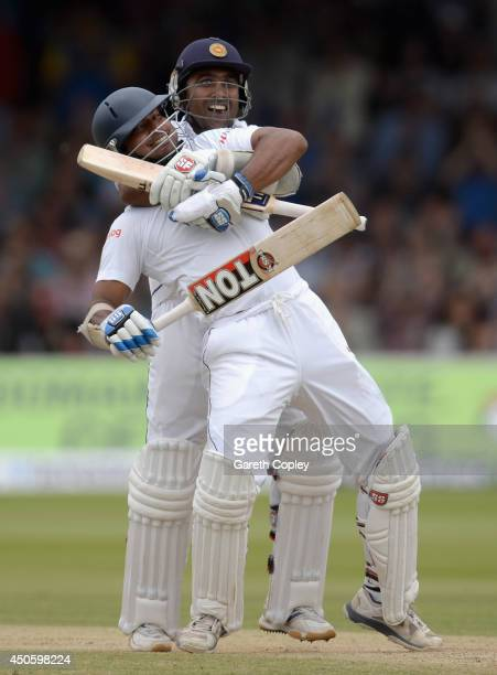 Kumar Sangakkara of Sri Lanka celebrates reaching his century with teammate Mahela Jayawardena during day three of 1st Investec Test match between...