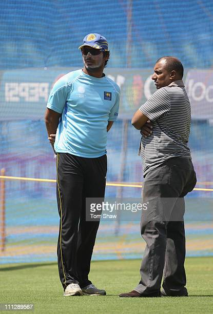 Kumar Sangakkara of Sri Lanka has a chat with former player Aravinda Da Silva during the Sri Lanka nets session at the Wankhede Stadium on March 31...