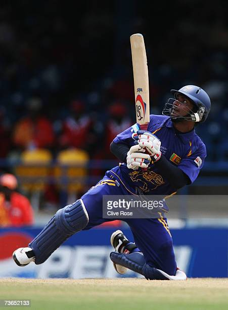 Kumar Sangakkara of Sri Lanka hits a six during the ICC Cricket World Cup 2007 Group B match between Bangladesh and Sri lanka at the Queens Park Oval...
