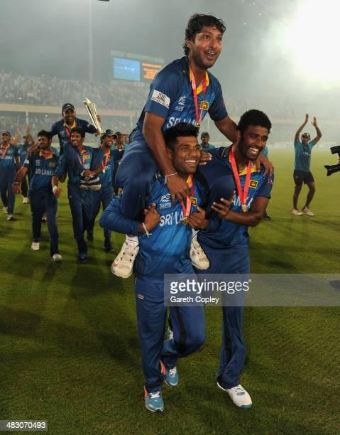 Kumar Sangakkara of Sri Lanka is chaired from the field by Seekuge Prasanna and Kusal Perera after winning the ICC World Twenty20 Bangladesh 2014...