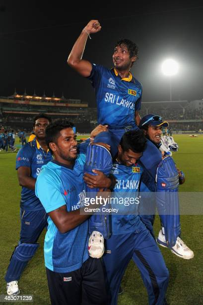 Kumar Sangakkara of Sri Lanka is chaired from the field by Seekuge Prasanna and Thisara Perera after winning the ICC World Twenty20 Bangladesh 2014...