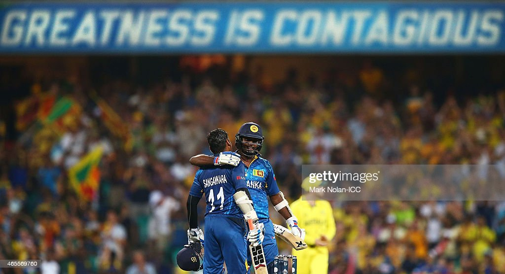 Kumar Sangakkara of Sri Lanka is congratulated by captain Angelo Mathews after he scored a century during the 2015 ICC Cricket World Cup match between Australia and Sri Lanka at Sydney Cricket Ground on March 8, 2015 in Sydney, Australia.