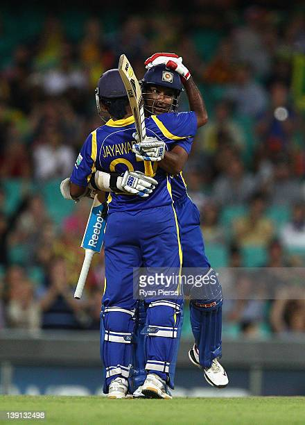 Kumar Sangakkara of Sri Lanka is congratulated by Mahela Jayawardene of Sri Lanka after he reached his 10000 One Day International runs during game...