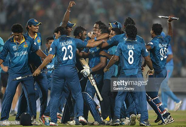 Kumar Sangakkara of Sri Lanka is mobbed by teammates in celebration after winning the ICC World Twenty20 Bangladesh 2014 Final between India and Sri...