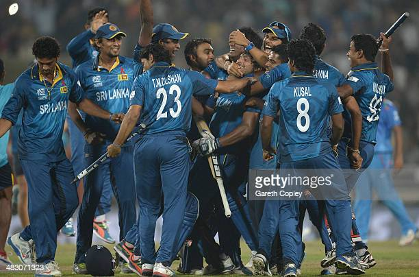 Kumar Sangakkara of Sri Lanka is mobbed by teammates in celebration after winning the ICC World Twenty20 Bangladesh 2014 Final between India and Sri...