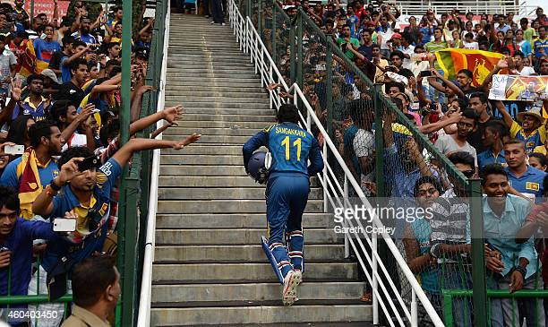 Kumar Sangakkara of Sri Lanka leaves the field after winning the 6th One Day International match between Sri Lanka and England at Pallekele Cricket...