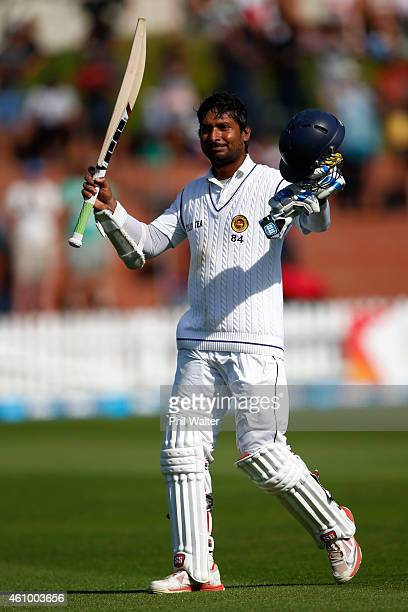 Kumar Sangakkara of Sri Lanka leaves the field on 203 runs after being caught by Trent Boult during day two of the Second Test match between New...