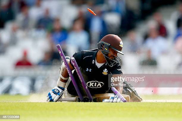Kumar Sangakkara of Surrey chrashes into his stumps after making his ground during the Royal London OneDay Cup Semi Final between Surrey and...