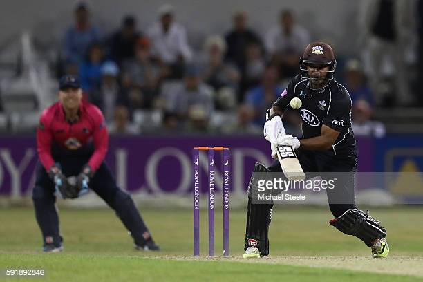 Kumar Sangakkara of Surrey hits a reverse sweep for six off the bowling of Mohammad Azharullah of Northants during the Royal London One-Day Cup...