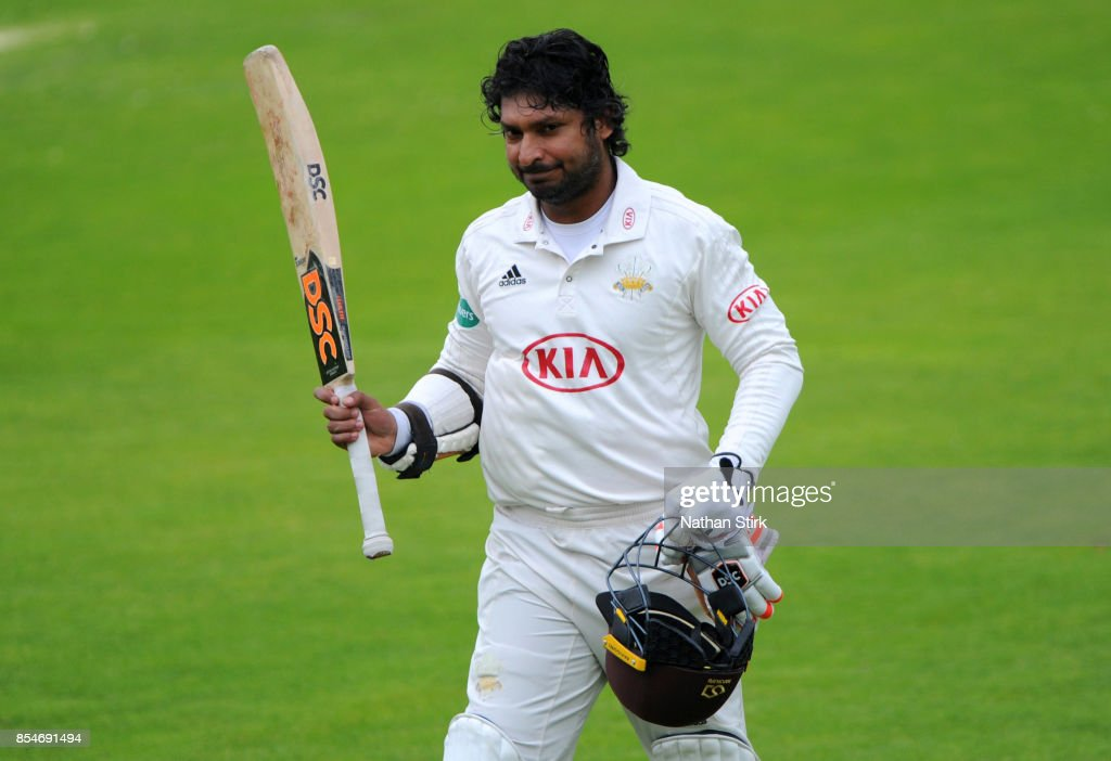 Kumar Sangakkara of Surrey is applauded off the pitch after his last innings during the County Championship Division One match between Lancashire and Surrey at Old Trafford on September 27, 2017 in Manchester, England.