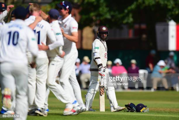Kumar Sangakkara of Surrey walks off after being caught out during the Specsavers County Championship Division One match between Surrey and Essex at...