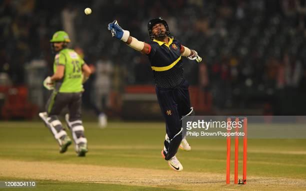 Kumar Sangakkara of the MCC fails to catch a ball during the T20 match between an MCC team and Lahore Qalandars at Gaddafi stadium on February 14,...