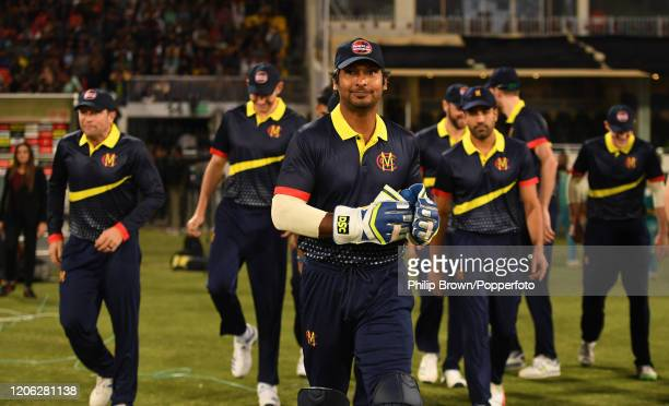Kumar Sangakkara of the MCC team leads his team on to the field for the match between MCC and Lahore Qalandars at Gaddafi stadium on February 14,...