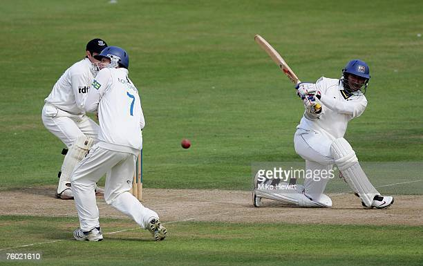 Kumar Sangakkara of Warkwickshire hits a boundary during the LV County Championship match between Sussex and Warwickshire at the County ground on...