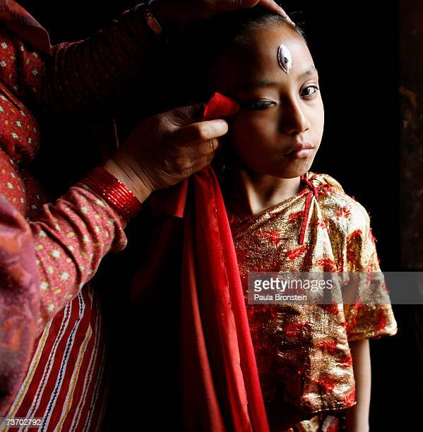 Kumari Devi Sajani Shakya gets ready for puja with the help of her mother Rukmani in a special room March 24 2007 in Bhaktapur Nepal As a royal...