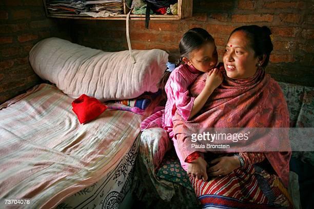 Kumari Devi Sajani Shakya shares a moment with her mother Rukmani at home on March 25 2007 in Bhaktapur Nepal As a royal Kumari Sajani has a very...
