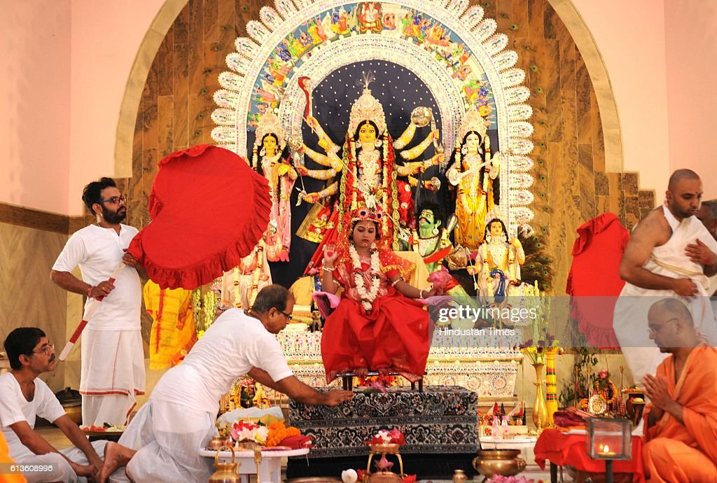 Kumari Kanya Puja performed at Ramkrishana Math to celebrate Maha Ashtami during the Durga Puja celebrations, on October 9, 2016 in Lucknow, India. Durga Ashtami or Maha Ashtami is one of the most auspicious days of ten-day long Durga Puja festival. This day is also known for 'Astra Puja' (weapons' worship) as the weapons of Goddess Durga are worshiped on this day.