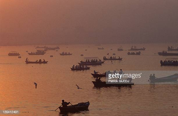 Kumbha Mela in India Ships taking pilgrims for their ablutions in the Sangam holy place where the Ganges the saraswati river and Yamuna meet