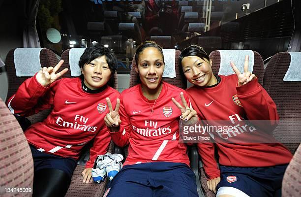 Kumi and Ami Taki Japanese college footballers pose with Alex Scott of Arsenal Ladies FC attend a training session at the Nishigaoka Stadium on...
