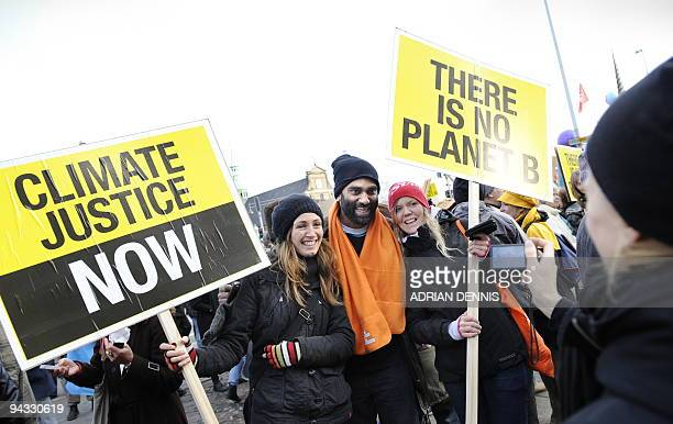 HOOD Kumi Naidoo Executive Director of Greenpeace International poses for a photograph with Climate change demonstrators as they gather outside The...