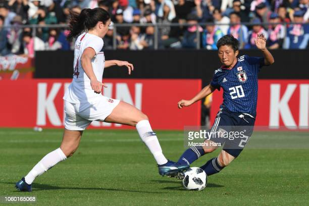 Kumi Yokoyama of Japan and Ingrid Syrstad Engen of Norway compete for the ball during the international friendly match between Japan and Norway at...