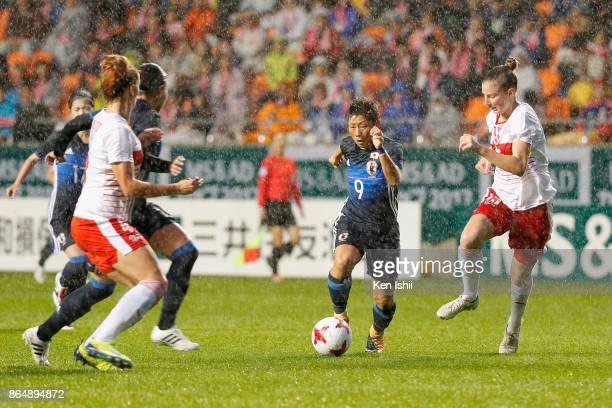 Kumi Yokoyama of Japan and Julia Stierli of Switzerland compete for the ball during the international friendly match between Japan and Switzerland at...