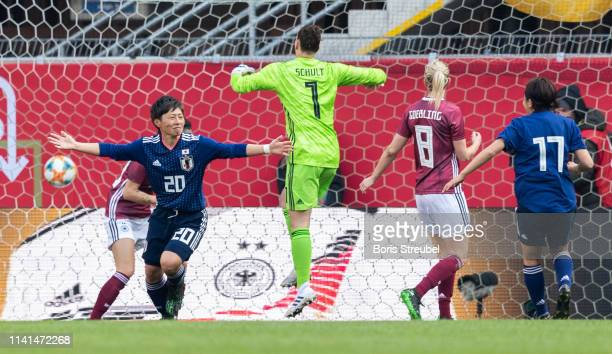 Kumi Yokoyama of Japan celebrates after scoring his team's second goal during the Women's International Friendly match between Germany and Japan at...