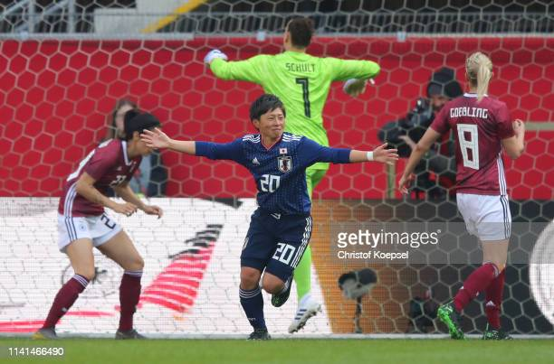 Kumi Yokoyama of Japan celebrates as she scores her team's second goal during the Women's International Friendly between Germany and Japan at...