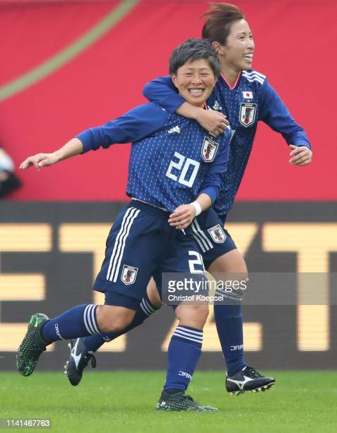 Kumi Yokoyama of Japan celebrates as she scores her team's second goal with Emi Nakajima during the Women's International Friendly between Germany...