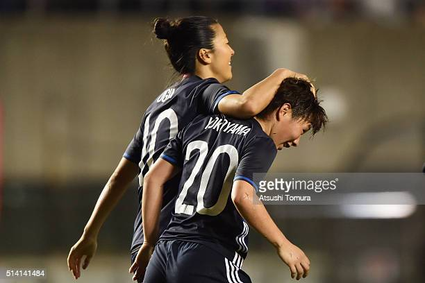 Kumi Yokoyama of Japan celebrates her team's fifth goal with her team mate Yuki Ogimi during the AFC Women's Olympic Final Qualification Round match...