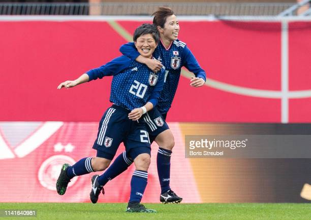 Kumi Yokoyama of Japan celebrates with team mates after scoring hier team's second goal during the Women's International Friendly match between...