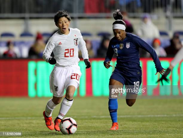 Kumi Yokoyama of Japan heads for the goal as Crystal Dunn of the United States defends during the SheBelieves Cup at Talen Energy Stadium on February...
