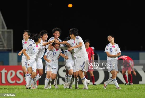 Kumi Yokoyama of Japan is congratulated by team-mates after scoring during the FIFA U17 Women's World Cup Semi Final match between North Korea and...