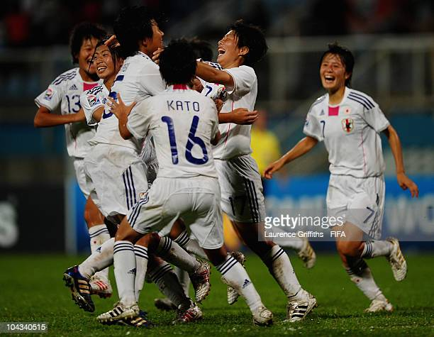 Kumi Yokoyama of Japan is mobbed after scoring the second goal during the FIFA U17 Women's World Cup Semi Final match between North Korea and Japan...