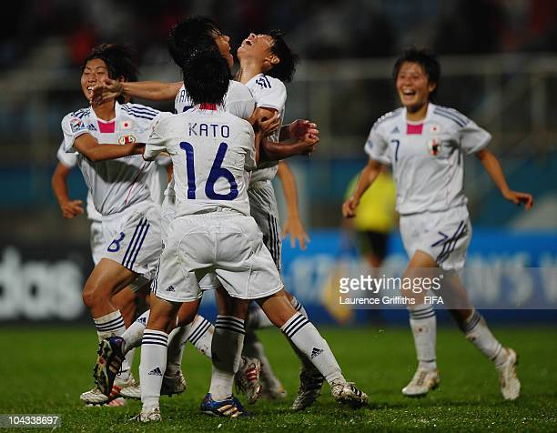 Kumi Yokoyama of Japan is mobbed after scoring the second gooal during the FIFA U17 Women's World Cup Semi Final match between North Korea and Japan...