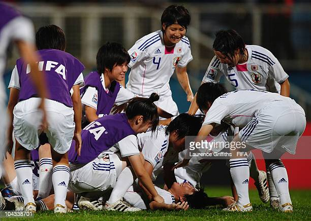 Kumi Yokoyama of Japan is mobbed on the final whistle after scoring the winning goal during the FIFA U17 Women's World Cup Semi Final match between...