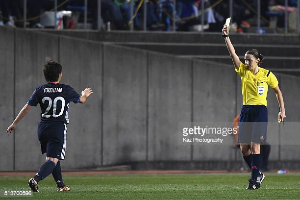 Kumi Yokoyama of Japan is shown a yellow card during the AFC Women's Olympic Final Qualification Round match between Japan and China at Kincho...