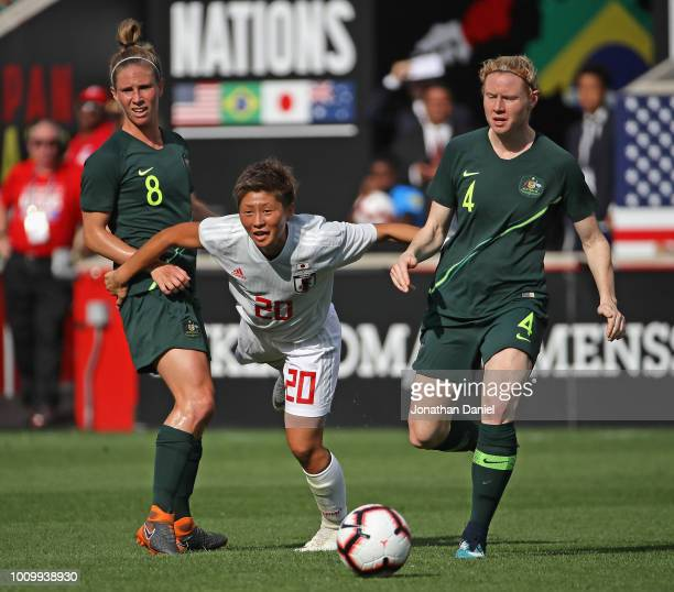 Kumi Yokoyama of Japan passes between defenders Elise KellondKnight and Claire Polkinghorne of Australia during the 2018 Tournament Of Nations at...