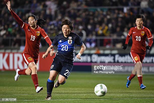 Kumi Yokoyama of Japan runs with the ball during the AFC Women's Olympic Final Qualification Round match between Japan and China at Kincho Stadium on...
