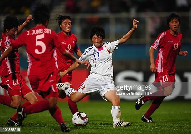 Kumi Yokoyama of Japan scores the second gooal during the FIFA U17 Women's World Cup Semi Final match between North Korea and Japan at the Ato Boldon...