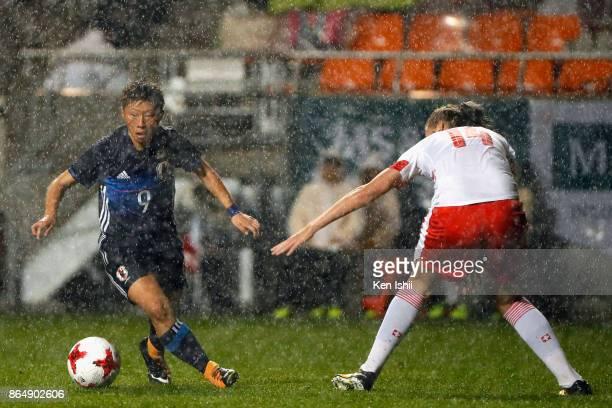 Kumi Yokoyama of Japan takes on Rahel Kiwic of Switzerland during the international friendly match between Japan and Switzerland at Nagano U Stadium...