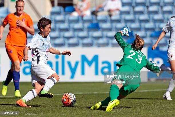 Kumi Yokoyama of Japan Women challenges Loes Geurts of Netherlands Women during the Women's Algarve Cup 5th place match between Japan and Netherlands...