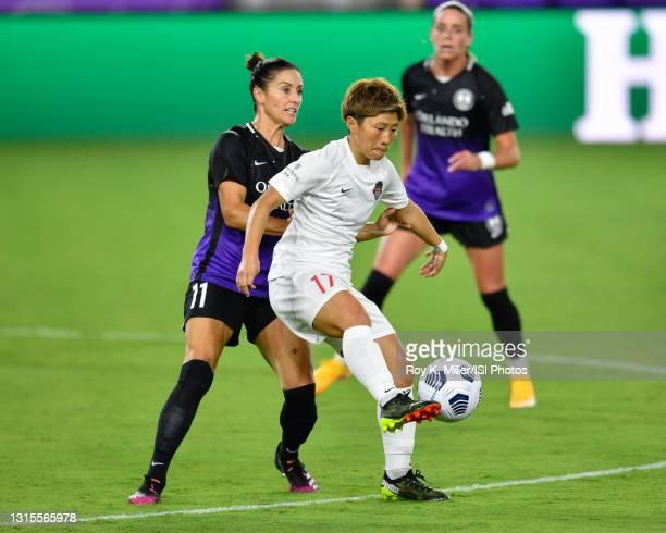 Kumi Yokoyama of the Washington Spirit controls the ball away from Ali Krieger of the Orlando Pride during a game between Washington Spirit and...